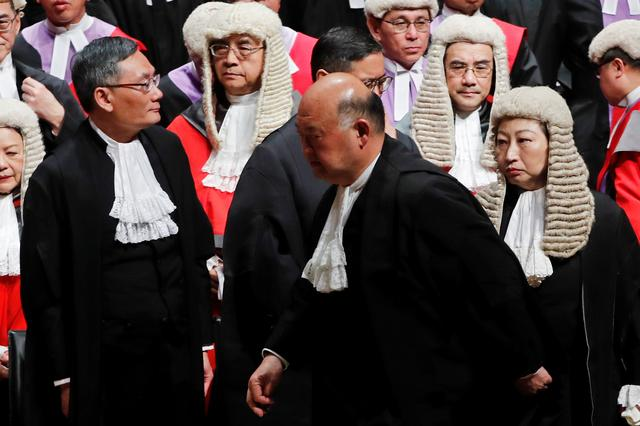 (L-R) Judge of the Court of Final Appeal Andrew Cheung Kui-nung, Hong Kong Chief Justice Geoffrey Ma Tao-li and Secretary of Justice Teresa Cheng attend a ceremony to mark the beginning of the legal year in Hong Kong, China January 14, 2019.  REUTERS/Tyrone Siu