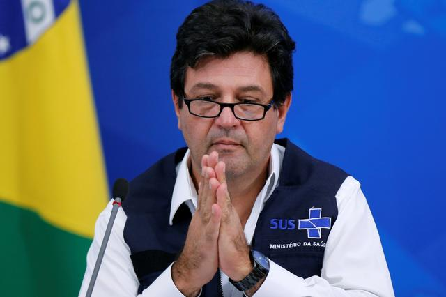FILE PHOTO: Brazil's Minister of Health Luiz Henrique Mandetta reacts during a news conference, amid the coronavirus disease (COVID-19) outbreak in Brasilia, Brazil April 14, 2020. REUTERS/Adriano Machado
