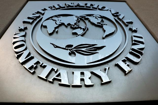 FILE PHOTO: The International Monetary Fund (IMF) logo is seen outside the headquarters building in Washington, U.S., as IMF Managing Director Christine Lagarde meets with Argentine Treasury Minister Nicolas Dujovne September 4, 2018. REUTERS/Yuri Gripas