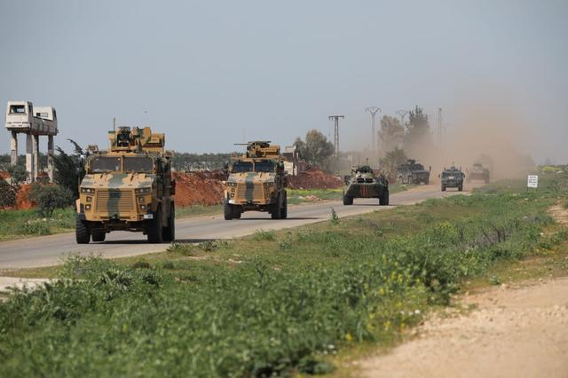 Turkish and Russian military vehicles take part in a joint patrol in the northern Idlib province, Syria, April 15, 2020. Turkish Defence Ministry/Handout via REUTERS