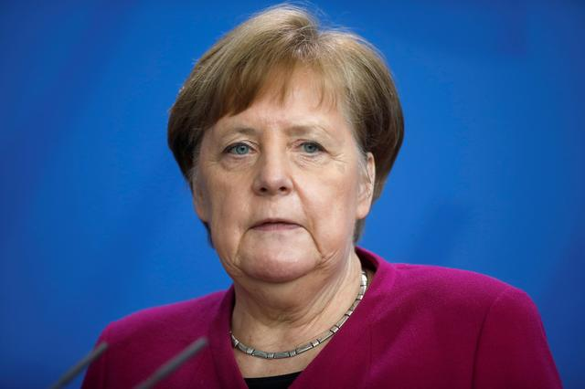 FILE PHOTO: German Chancellor Angela Merkel attends a media briefing about measures of the German government to avoid further spread of the coronavirus disease (COVID-19) at the chancellery in Berlin, Germany, April 9, 2020. Markus Schreiber/Pool via REUTERS/File Photo