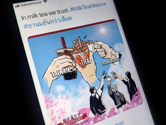 "A mobile phone displays an internet meme of a growing online movement called ""Milk Tea Alliance"" to show solidarity between Thailand, Taiwan and Hong Kong, in this illustration taken on April 15, 2020. REUTERS/Patpicha Tanakasempipat/Illustration"