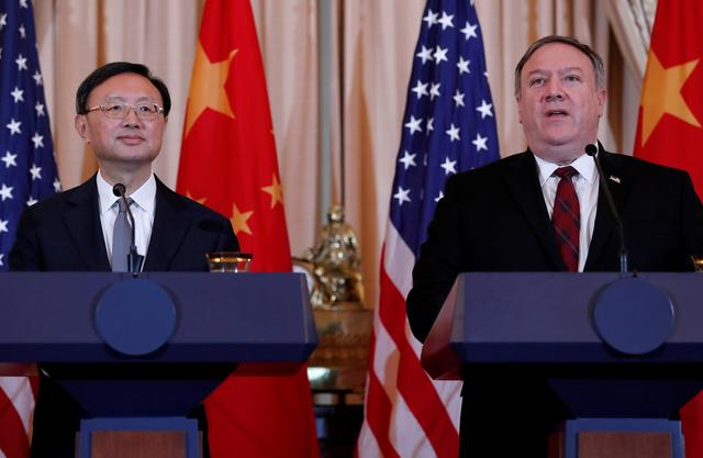 FILE PHOTO: U.S. Secretary of State Mike Pompeo, right, speaks as Chinese Communist Party Office of Foreign Affairs Director Yang Jiechi listens as the two countries hold a joint news conference after participating in a second diplomatic and security meeting at the U.S. Department of State, Washington, U.S., November 9, 2018. REUTERS/Leah Millis