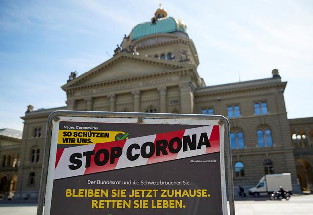 A sign is pictured in front of the Swiss Parliament Building (Bundeshaus) during a federal council meeting on the outbreak of the coronavirus disease (COVID-19) in Bern, Switzerland, April 16, 2020. REUTERS/Denis Balibouse