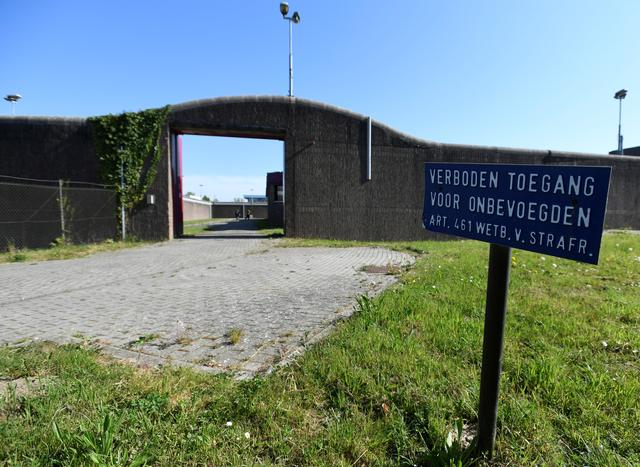 "A sign reading ""forbidden entry for unauthorised persons"" marks the entrance of the old Overmaze prison serving as shelter for homeless people as the existing one of the Salvation Army is closed due to the spread of coronavirus disease (COVID-19) in Maastricht, Netherlands, April 16, 2020. REUTERS/Piroschka van de Wouw"