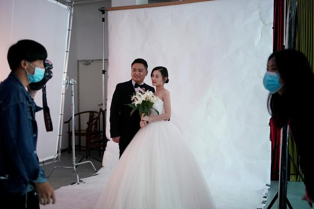 Peng Jing, 24, and Yao Bin, 28, pose for their wedding photography shoot after the lockdown was lifted in Wuhan, capital of Hubei province and China's epicentre of the novel coronavirus disease (COVID-19) outbreak, April 15, 2020. Picture taken April 15, 2020. REUTERS/Aly Song