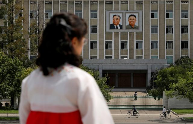 FILE PHOTO: Portraits of late North Korean leaders Kim Il Sung and Kim Jong Il are seen on the facade of a government building in Pyongyang, North Korea, September 11, 2018. REUTERS/Danish Siddiqui/File Photo