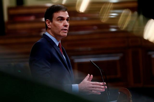 FILE PHOTO: Spanish Prime Minister Pedro Sanchez delivers his speech during a session on coronavirus disease (COVID-19) at Parliament in Madrid, Spain, April 9, 2020. Mariscal/Pool via REUTERS