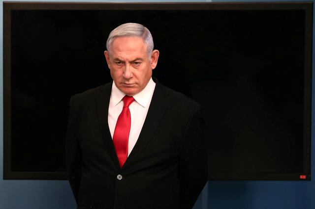 FILE PHOTO: Israeli Prime Minister Benjamin Netanyahu arrives for a speech at his Jerusalem office, regarding the new measures that will be taken to fight the coronavirus, March 14, 2020. Gali Tibbon/Pool via REUTERS