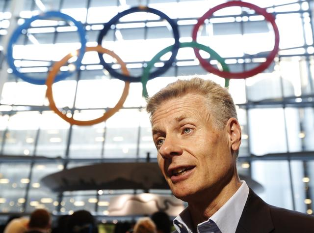 FILE PHOTO: The CEO of the London Organising Committee of the Olympic and Paralympic Games (LOCOG), Paul Deighton, speaks during an interview at  an unveiling ceremony for Olympic Rings in the Terminal Five arrivals hall at Heathrow Airport,  in preparation for the London 2012 Olympic Games in London June 20, 2012.   REUTERS/Luke MacGregor
