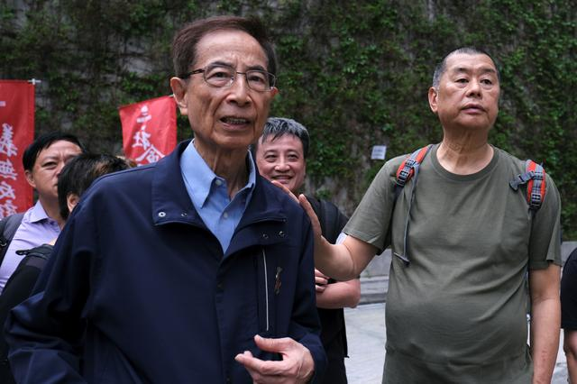 FILE PHOTO: Hong Kong politician Martin Lee and Founder of Next Media Jimmy Lai march during a protest to demand authorities scrap a proposed extradition bill with China, in Hong Kong, China March 31, 2019. REUTERS/Tyrone Siu