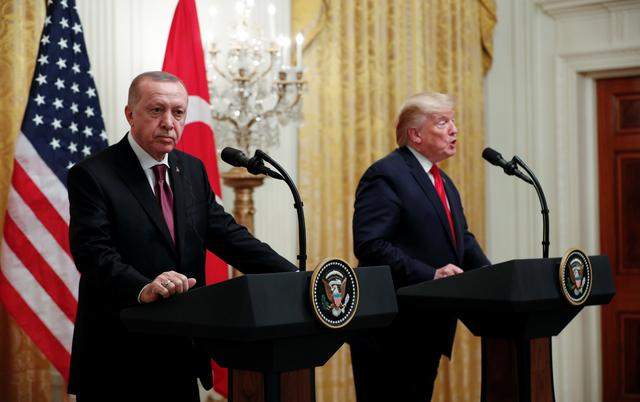 FILE PHOTO: U.S. President Donald Trump and Turkey's President Tayyip Erdogan hold a during a joint news conference at the White House in Washington, U.S., November 13, 2019. REUTERS/Tom Brenner