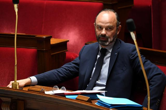 FILE PHOTO: French Prime Minister Edouard Philippe looks on during a session of questions to the government at the National Assembly in Paris, France April 7, 2020. Alain Jocard/Pool via REUTERS