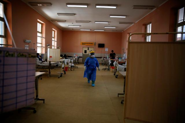 FILE PHOTO: A nurse walks in a ward reserved for patients diagnosed with the coronavirus disease (COVID-19) at the Dos de Mayo national hospital, in Lima, Peru April 16, 2020. REUTERS/Sebastian Castaneda