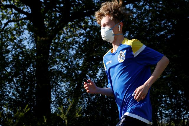A youth is pictured running in Bristol as the spread of the coronavirus disease (COVID-19) continues, Bristol, Britain, April 20, 2020. REUTERS/Eddie Keogh