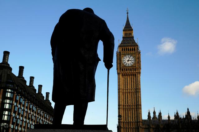 FILE PHOTO: The statue of Britain's former Prime Minister Winston Churchill is silhouetted in front of the Houses of Parliament in London January 24, 2015.   REUTERS/Luke MacGregor