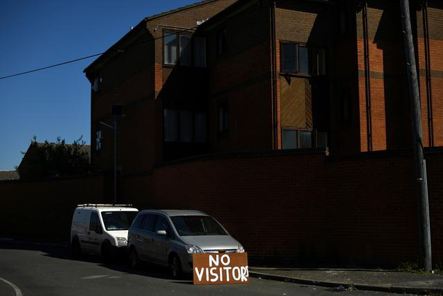 A 'No Visitors' sign is seen in Kingston upon Thames, amid the coronavirus disease (COVID-19) outbreak, in London, Britain April 21, 2020.   REUTERS/Dylan Martinez/File Photo
