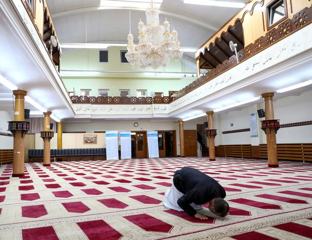 Imam Mohamed Taha Sabri of Dar Assalam Mosque in Neukoelln demonstrates how to perform prayers during an interview with Reuters in the mosque, as the global spread of the coronavirus disease (COVID-19) continues, in Berlin, Germany, April 17, 2020. REUTERS/Christian Mang