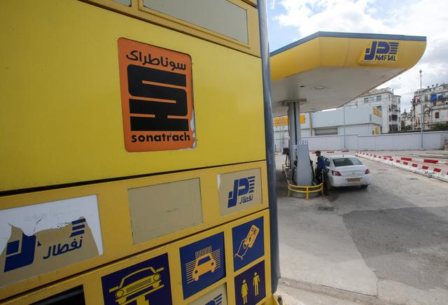 A car is filled with fuel at a gas station in Algiers, Algeria April 21, 2020. REUTERS/Ramzi Boudina