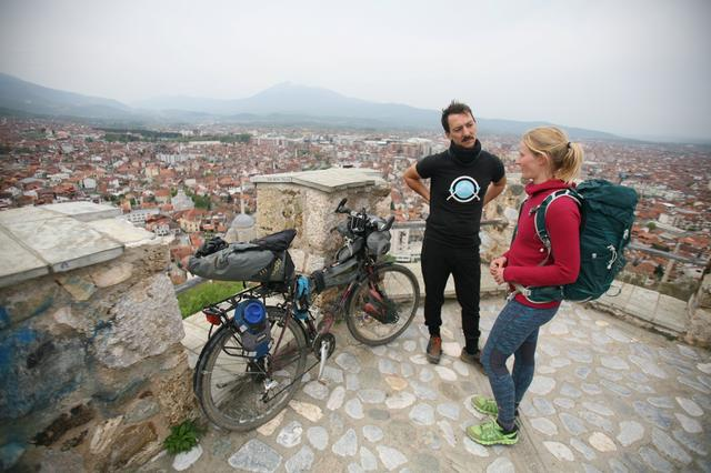 Mike Elm, a Scottish cyclist who left Edinburgh last November on a two-year-long cycling journey to collect stories of people and businesses responding to climate crisis and his colleague Rosie Watson on a similar journey on foot are stuck following the coronavirus disease (COVID-19) travel restrictions in Prizren, Kosovo April 20, 2020. REUTERS/Bardh Krasniqi