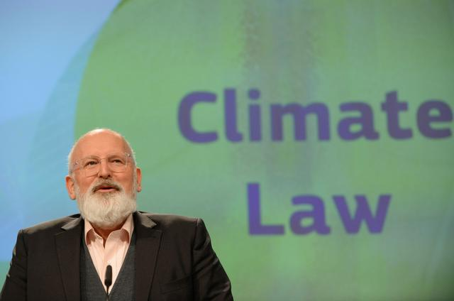 FILE PHOTO: European Commission Vice-President Frans Timmermans presents a new law for the bloc to achieve carbon neutrality by 2050 in Brussels, Belgium March 4, 2020. REUTERS/Johanna Geron
