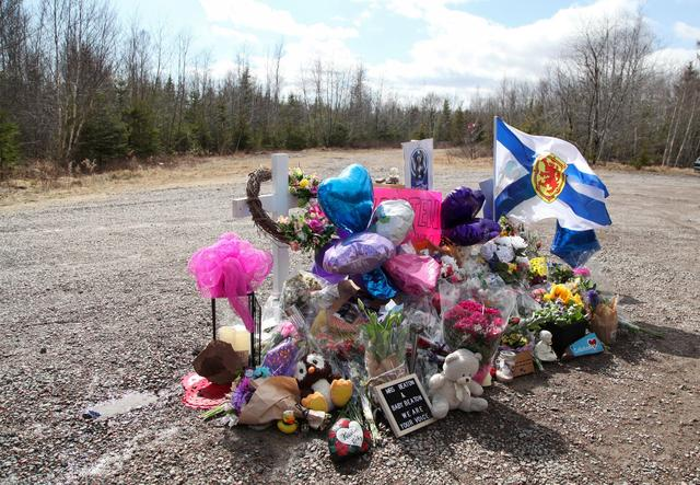 The makeshift memorial that has been placed in the memory of Kristen Beaton, who was expecting her third child and was killed along Plains Road during Sunday's mass shooting is seen in Debert, Nova Scotia, Canada April 23, 2020. REUTERS/Tim Krochak
