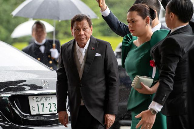 FILE PHOTO: Philippines President Rodrigo Duterte arrives to attend the enthronement ceremony of Japan's Emperor Naruhito in Tokyo, Japan October 22, 2019.  Carl Court/Pool via REUTERS