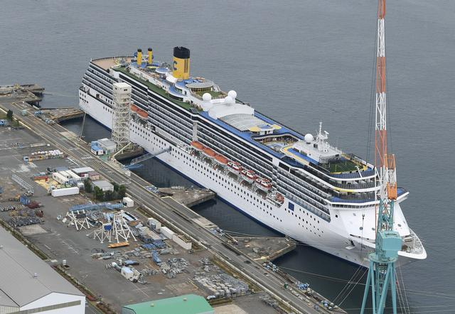 FILE PHOTO: An aerial view shows Italian cruise ship Costa Atlantica, which had confirmed 33 cases of the coronavirus disease (COVID-19) infection, in Nagasaki, southern Japan April 21, 2020. in this photo taken by Kyodo. Picture taken April 21, 2020. Kyodo/via REUTERS