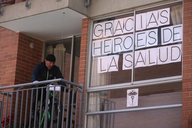 "A sign that reads ""Thank you health heroes"" is seen in the window of the Abedules De Santafe residential complex, where a doctor who said he was threatened with death resides, amid the outbreak of the coronavirus disease (COVID-19) in Bogota, Colombia April 24, 2020. REUTERS/Luisa Gonzalez"