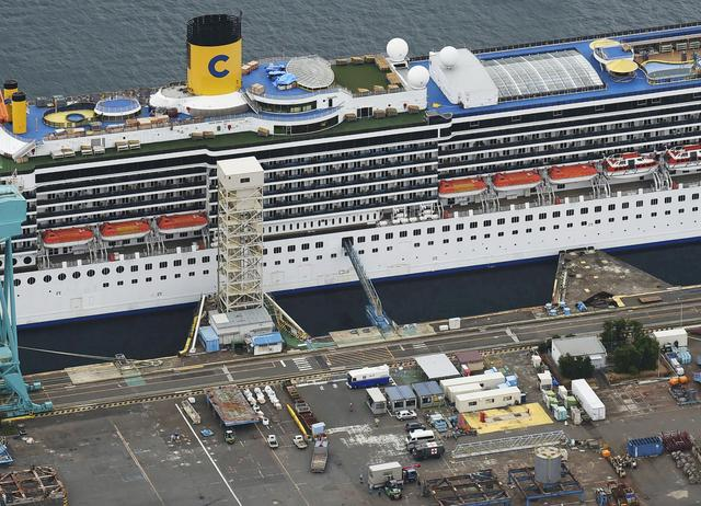 FILE PHOTO: An aerial view shows Italian cruise ship Costa Atlantica, which has crew members confirmed with cases of the coronavirus disease (COVID-19) infection, in Nagasaki, southern Japan April 23, 2020, in this photo taken by Kyodo. Mandatory credit Kyodo/via REUTERS