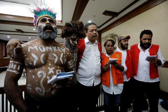 FILE PHOTO:  Dano Anes Tabuni, Ambrosius Mulait, Paulus Suryanta Ginting, Arina Elopere, Charles Kossay, and Isay Wenda, pro-Papuan activists who were arrested on suspicion of treason, sing a solidarity song as they arrive at the courtroom before their trial at Central Jakarta District Court in Jakarta, Indonesia, December 19, 2019. REUTERS/Willy Kurniawan