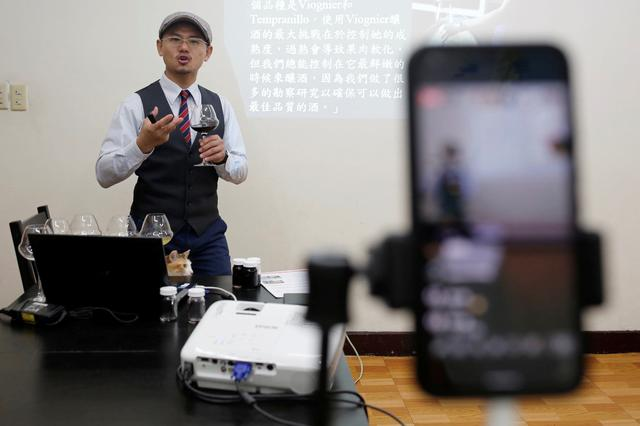 Peter Petrus, 37, a Taiwanese sommelier, conducts an online wine tasting class from his studio, during the global outbreak of the coronavirus disease (COVID-19), in Taipei, Taiwan, April 24, 2020. . REUTERS/Ann Wang