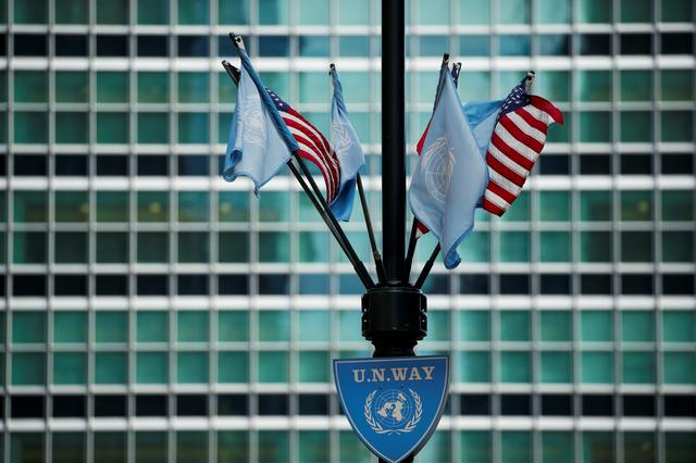 FILE PHOTO: Flags of U.S. and U.N. are seen near the UN building where heads of state and officials are attending the 73rd session of the United Nations General Assembly at U.N. headquarters in New York, U.S., September 27, 2018. REUTERS/Eduardo Munoz