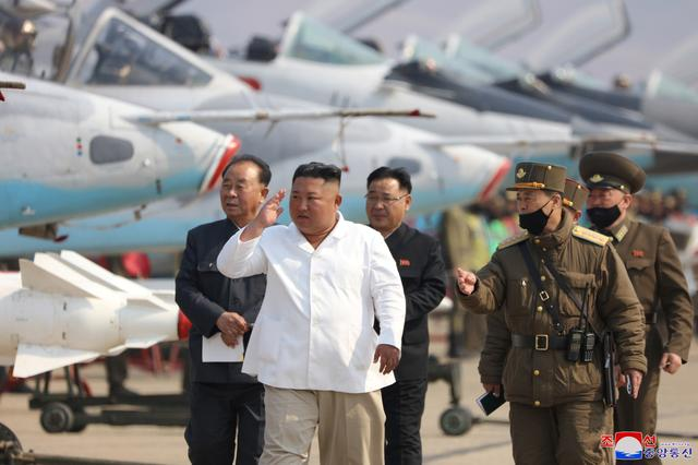 North Korean leader Kim Jong Un visits a pursuit assault plane group under the Air and Anti-Aircraft Division in the western area  in this undated image released by North Korea's Korean Central News Agency (KCNA) in Pyongyang on April 12, 2020. KCNA/via REUTERS