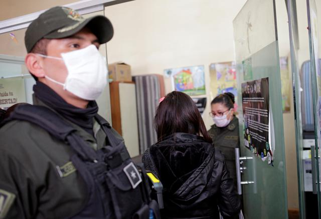 A woman enters an office of Bolivia's Anti-Violence Task Force FELCV, after accusing her partner of domestic abuse, during the outbreak of the coronavirus disease (COVID-19), in La Paz, Bolivia April 22, 2020. Picture taken April 22, 2020. REUTERS/David Mercado