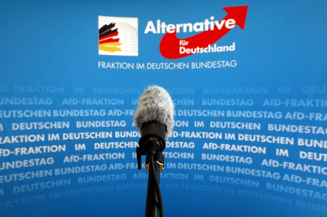 FILE PHOTO: A microphone stands in front of an AfD (Alternative fuer Deutschland) logo on the press wall of the German Bundestag in Berlin, March 12, 2020. REUTERS/Michele Tantussi/File Photo