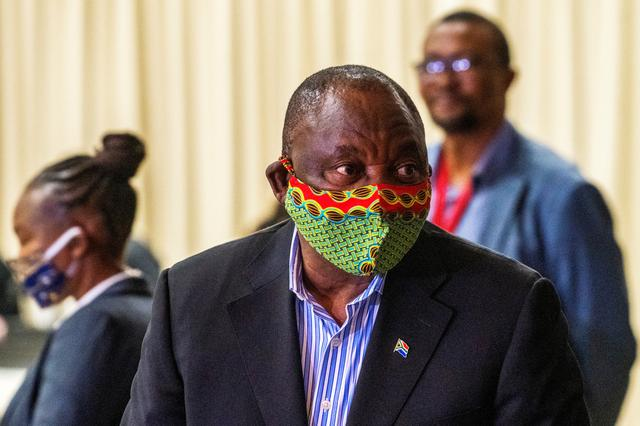 FILE PHOTO: South African President Cyril Ramaphosa visits the coronavirus disease (COVID-19) treatment facilities at the NASREC Expo Centre in Johannesburg, South Africa April 24, 2020. Jerome Delay/Pool via REUTERS
