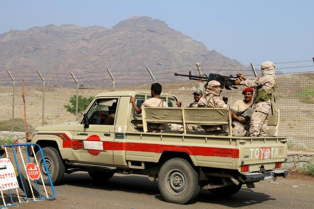 FILE PHOTO: Southern Yemeni separatist security members patrol a street during a campaign to seize unlicensed motorcycles in Aden, Yemen December 10, 2019. REUTERS/Fawaz Salman