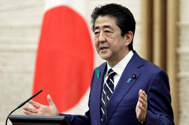 FILE PHOTO: Japan's Prime Minister Shinzo Abe gestures as he speaks during a news conference at the prime minister's official residence in Tokyo, Japan April 17, 2020. Kiyoshi Ota/Pool via REUTERS