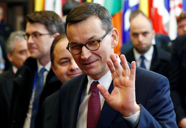 FILE PHOTO: Poland's Prime Minister Mateusz Morawiecki waves as he leaves after the second day of the European Union leaders summit, held to discuss the EU's long-term budget for 2021-2027, in Brussels, Belgium, February 21, 2020. REUTERS/Francois Lenoir