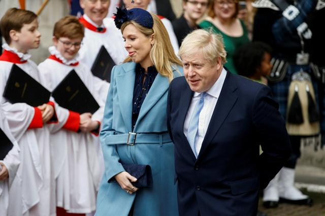 FILE PHOTO: Britain's Prime Minister Boris Johnson and his partner Carrie Symonds leave after the annual Commonwealth Service at Westminster Abbey in London, Britain March 9, 2020. REUTERS/Henry Nicholls/File Photo