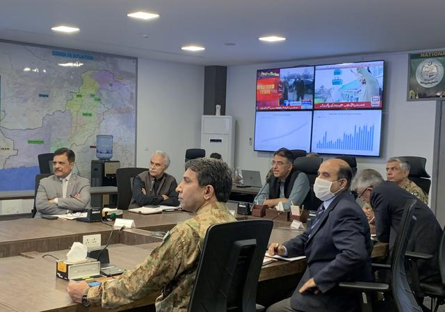 Pakistan's Planing Minister Asad Umar, along with health officials address a briefing, following the spread of the coronavirus disease (COVID-19), at the National Command and Control Centre in Islamabad, Pakistan April 29, 2020. REUTERS/Gibran Peshimam