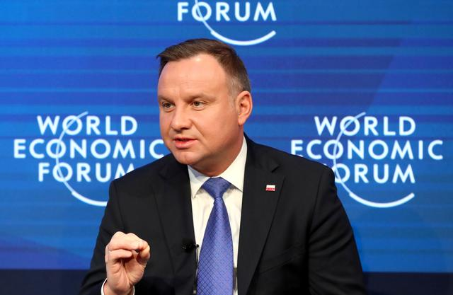 FILE PHOTO: Poland's President Andrzej Duda attends a session at the 50th World Economic Forum (WEF) annual meeting in Davos, Switzerland, January 23, 2020. REUTERS/Denis Balibouse/File Photo