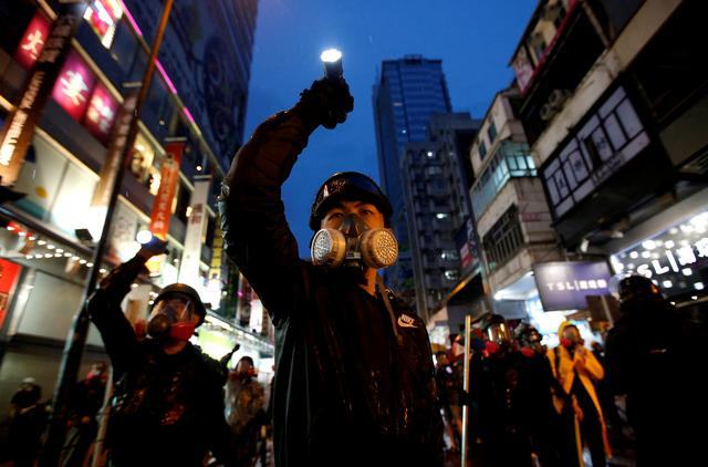 Demonstrators protesting the proposed extradition bill aim their flashlights towards riot police as they are chased through the streets of Hong Kong, China, August 25, 2019. Reuters has been awarded the 2020 Pulitzer Prize in Breaking News Photography for Hong Kong protests. REUTERS/Willy Kurniawan
