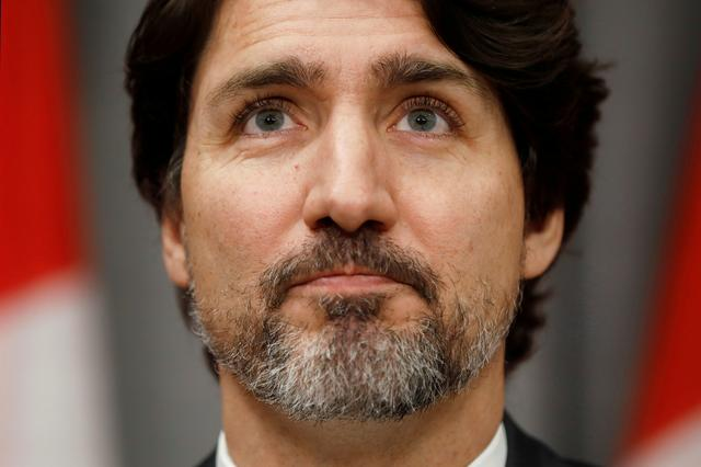 FILE PHOTO: Canada's Prime Minister Justin Trudeau pauses during a news conference on Parliament Hill in Ottawa, Ontario, Canada May 1, 2020. REUTERS/Blair Gable