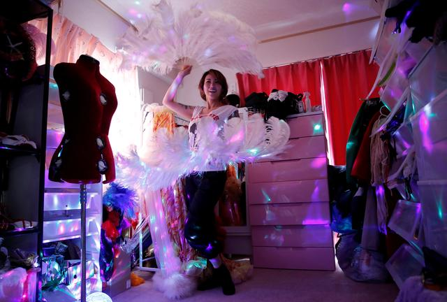 Burlesque show exotic dancer Aya Yumiko who performs under the name Aya Mermaid, poses with her show props at her house amid the coronavirus disease (COVID-19) outbreak, in Tokyo, Japan, April 21, 2020. REUTERS/Kim Kyung-Hoon