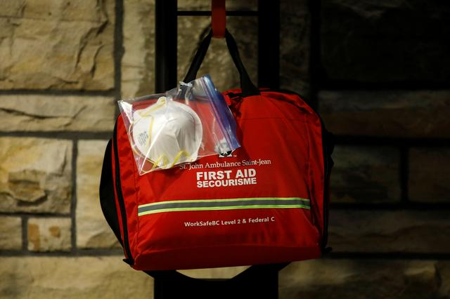FILE PHOTO: A N95 face mask attached to a first aid kit is seen near the House of Commons, as efforts continue to help slow the spread of the coronavirus disease (COVID-19), on Parliament Hill in Ottawa, Ontario, Canada April 29, 2020. REUTERS/Blair Gable