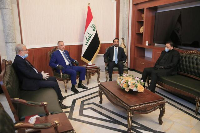 The speaker of Iraq's parliament Mohammed al-Halbousi meets with Iraqi Prime Minister-designate Mustafa al-Kadhimi before the vote on the new government at the parliament headquarters in Baghdad, Iraq, May 6, 2020. Iraqi Parliament Media Office/Handout via REUTERS