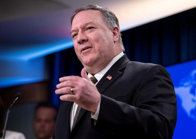 FILE PHOTO: U.S. Secretary of State Mike Pompeo speaks at a press briefing at the State Department in Washington, U.S., April 22, 2020.  Nicholas Kamm/Pool via REUTERS/File Photo