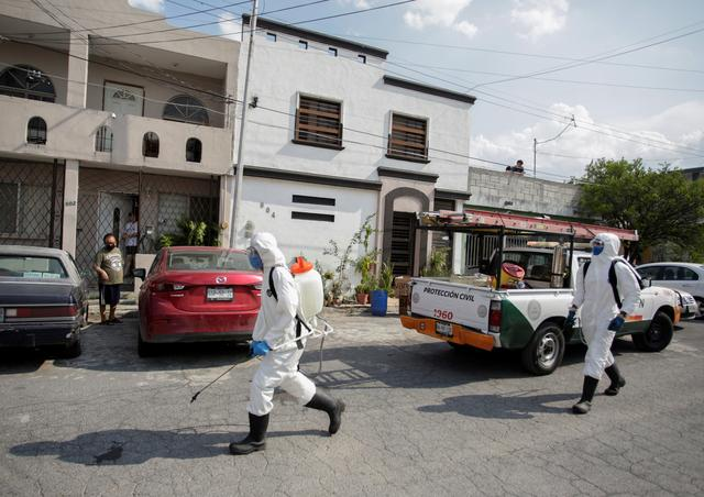 "Municipal workers sanitize the surroundings of the nursing house ""Retirement House Luis Elizondo"", where people have been infected by the coronavirus disease (COVID-19) according to local media, in Guadalupe, on the outskirts of Monterrey, Mexico May 6, 2020. REUTERS/Daniel Becerril"